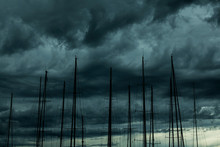 High Section Of Sailboats Against Cloudy Sky