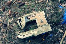 Old Broken Seewing Machine Lying In The Trash.