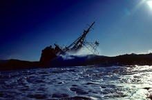 Ship Sinking In Sea Against Sky