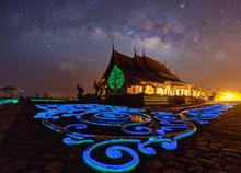 Milky Way Night Scene At Wat Sirindhorn Wararam Or Wat Phu Prao,Buddhist Temple In Ubon Ratchathani Province,Thailand