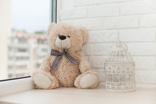 Teddy Bear On Windowsill Alone