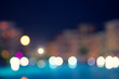 City night. Lights broke and blurred background. De focused urban street. Blur effect.
