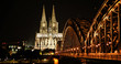 Panoramic View Of Illuminated Bridge And Buildings At Night