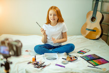 Young Beautiful Caucasian Child Blogger Show Her New Decorative Cosmetics At Camera, Share Opinion With Subscribers. Blog, Vlog Concept