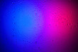 canvas print picture - Drops of water on glass in pink-blue neon light. Rain on the glass against the background of two colored lights. Abstract photo for background.