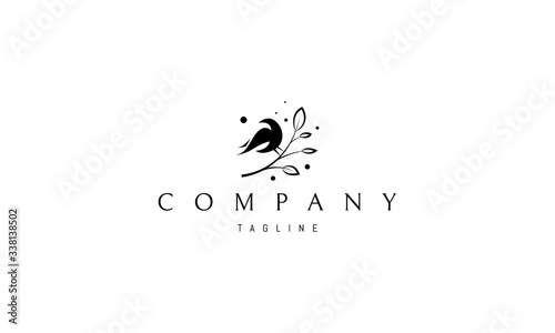 Fotografía Vector logo on which an abstract image of a bird sitting on a branch