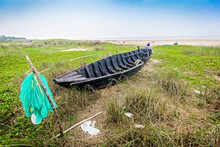 High Angle View Of Abandoned Fishing Boat On Land