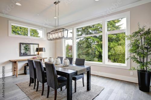 Fotografija Luxurious modern dining room boasts a black dining table