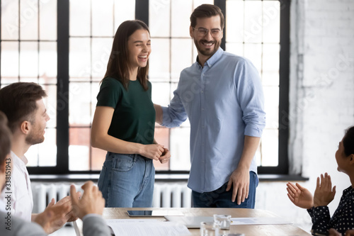 Fotomural Smiling male employer introduce excited female newcomer to overjoyed diverse cow