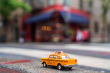 Model Taxi Car Is Parked On Th...