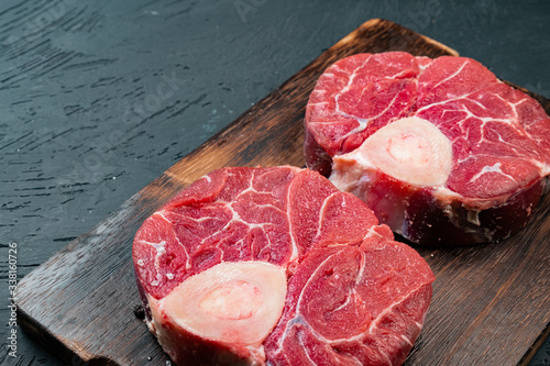 Raw beef fillet steaks on wooden background, close up. Wallpaper Mural