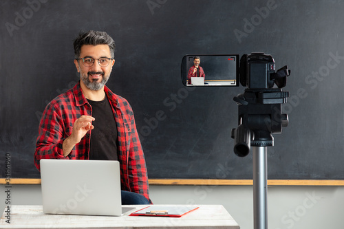 Stampa su Tela Adult man teacher is filming movie for online education.