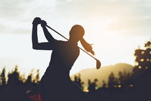 Silhouette Of  Young Professional Female Golf Player Hit Sweeping And Keep Golf Course Doing Golf Swing,she Does Exercise For Relax Time