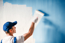 Painter Painting A Wall With P...