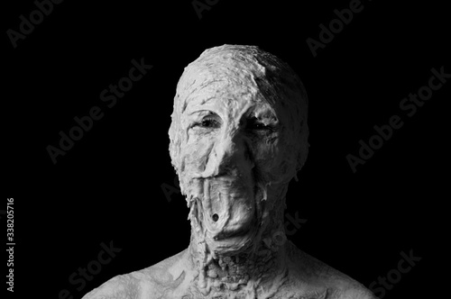 Fotografie, Obraz portrait of a shapeless distorted face on a black background