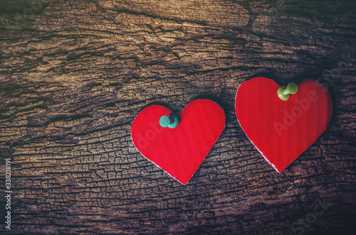 Close-up Of Heart Shape Decorations On Wooden Table