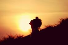 Silhouette Man Standing On Lan...