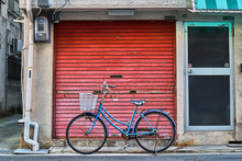 Bicycle In Front Of A Brick Wall
