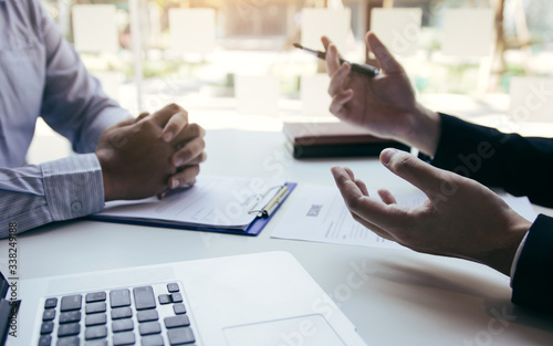 Job applicants are holding a resume document in the job interview room, job interview concept Canvas Print