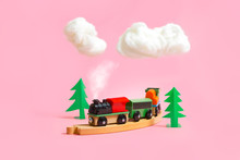 Wooden Colorful Toy Train With Details On Pink Background. Preschool And Kids Game Concept