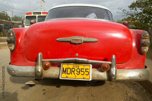 Old red Pontiac with a Cuban license plate in Havana, Cuba Wallpaper Mural