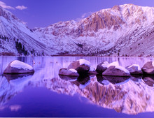 Sunrise Reflection At Convict Lake In The Eastern Sierras In California.