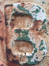 Close-up Of Weathered Rusty Metallic Letter B