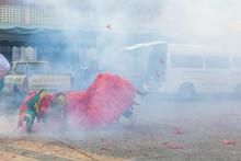 Traditional Dragon Dance And Smoke On Street