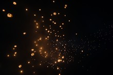 Low Angle View Of Illuminated Sky Lanterns At Night