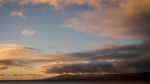 Timelapse Of Sunset Light On Beautiful Slow-Moving Clouds Over Molokai From West Maui