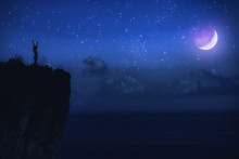 Silhouette Of A Woman With Milky Way Stars Above The Ocean Horizon.