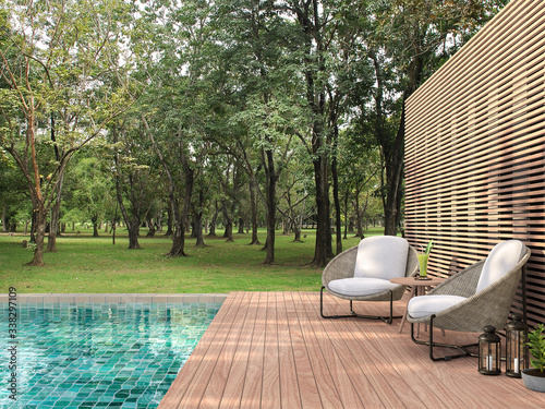 Fototapeta Swimming pool terrace with garden view 3d render,  There are a wooden floor ,green tile in the swimming pool and ,wooden lath wall,Decorated with rattan furniture,Surrounded by nature. obraz