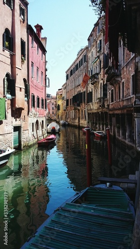 Fototapety, obrazy: Canal Passing Through Buildings In City