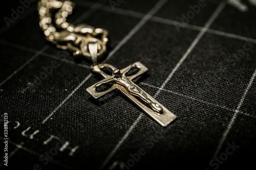 Close-up Of Cross Pendant Fototapete