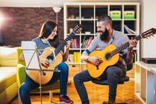 Guitar Teacher Teaching The Girl At Home.