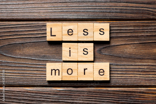 Fotomural less is more word written on wood block