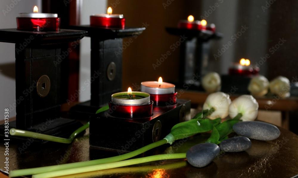 Fototapeta masaż znicz świeczka kwiat  świecznik