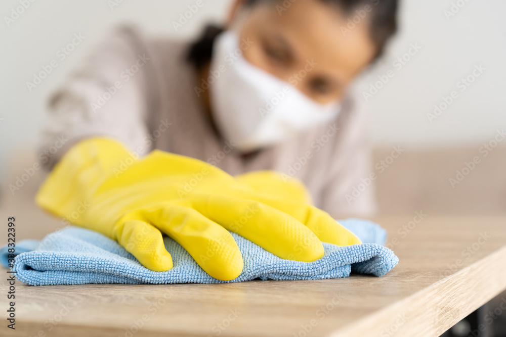 Fototapeta Hand of women cleaning for COVID-19 disease prevention and wipe with a cloth to protect infection and bacteria. Concept of  hygiene in life And health at home