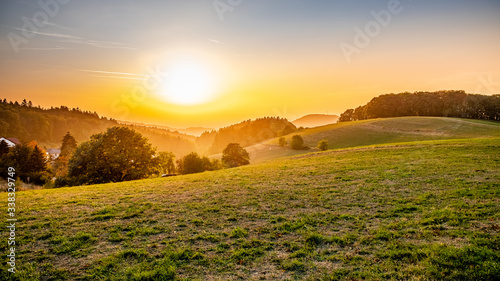 Scenic View Of Field Against Sky During Sunset - fototapety na wymiar