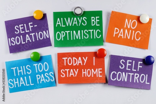 Photo Multi colored stickers with messages  stay at home, self-isolatuon, self- c
