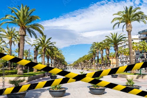 Barrier tape against Passeig Jaume I in Salou Wallpaper Mural