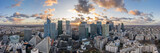 Aerial panoramic drone shot of La Defense skycraper in Paris business district with clouds during sunset