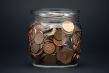 Glass Jar With The Coins On A ...