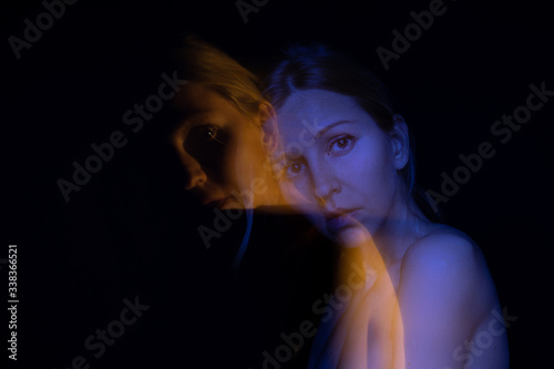 Sensible double portrait of young slim woman looking to the camera Canvas Print