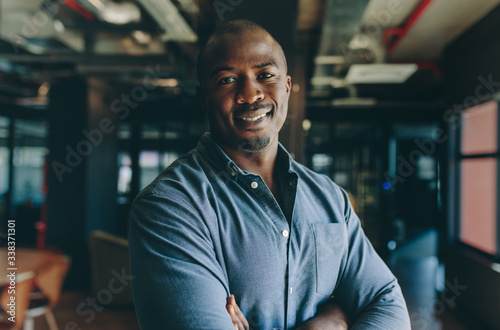 Confident businessman standing in office Fototapeta