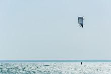 Person Kitesurfing On A Beach On The Island Of Mallorca, Mediterranean Sea