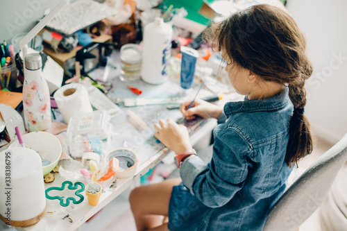 portrait of young child girl crafting at home Fototapeta