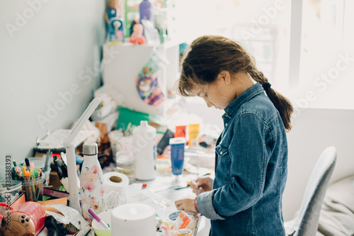portrait of young child girl crafting at home Canvas Print