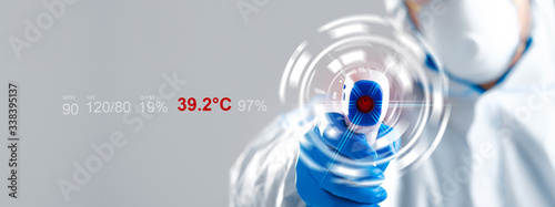 Obraz Unrecognizable person in protective suit holding digital thermometer, collage with health parameters on screen - fototapety do salonu