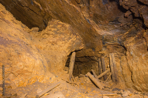 Abandoned underground bauxite mine tunnel with ore pillar Canvas Print